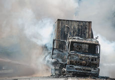 Road accidents during daylight hours. SURATTHANI THAILAND- AUG 17: Police firefighter rescuers helped extinguish a burning tractor trailer trucks horn pure Stock Photography