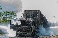 Road accidents during daylight hours. SURATTHANI THAILAND- AUG 17: Police firefighter rescuers helped extinguish a burning tractor trailer trucks horn pure Royalty Free Stock Image