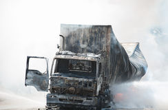 Road accidents during daylight hours. SURATTHANI THAILAND- AUG 17: Police firefighter rescuers helped extinguish a burning tractor trailer trucks horn pure Stock Image