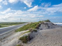 Road accross the sand dunes at. Outer Banks, North Carolina, USA Royalty Free Stock Image