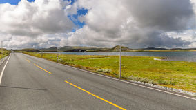 Road across Hardangervidda plateau in Norway Stock Photos