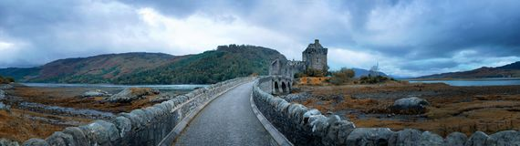 The road across Loch Duich to Eilean Donan Castle. In the Highlands of Scotland. Blue hour panorama in autumn Royalty Free Stock Images