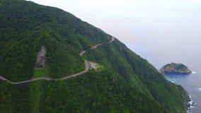 Road across Yilan Coastline in Taiwan. Mountan Terrain of North East Sea Shore near Taipei City. Aerial View. Shot with a DJI Mavic fps 29,97 4k stock video footage