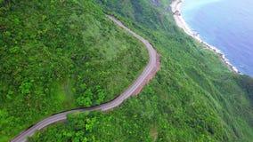Road across Yilan Coastline in Taiwan. Mountan Terrain of North East Sea Shore near Taipei City. Aerial View. Shot with a DJI Mavic fps 29,97 4k stock video