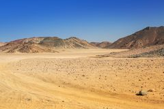 Scenery of the african desert. Road through the african desert of Egypt Royalty Free Stock Photo