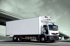 On a road again. White frigo truck on road Royalty Free Stock Image