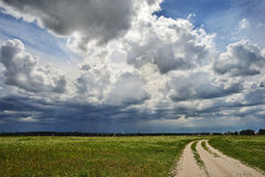 Road against the cloudy sky Royalty Free Stock Image