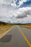The Road ahead. Photo of a highway in Tibet Stock Image