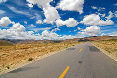 The Road ahead. Photo of a highway in Tibet Royalty Free Stock Photography