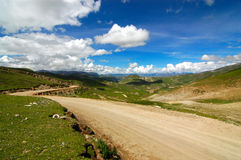 The Road ahead. Photo of a road in Tibet Royalty Free Stock Photo