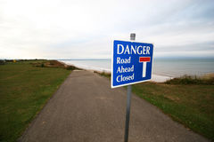 Road ahead closed. Danger sign on road that has been eroded and fallen into the sea royalty free stock images