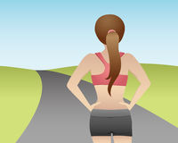 The Road Ahead. A female runner faces the challenge of the road ahead Stock Image