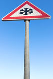 Road ahead freezes easily. German road sign: road ahead freezes easily and is then slippery stock photography