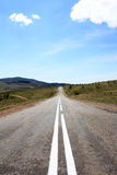 The road ahead. Is visible perspective and marking line, which is receding into the distance creates depth pictures Royalty Free Stock Image