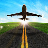 Road and airplane take off Royalty Free Stock Image