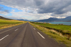 Road Akureyri in Iceland. Paved road on the shores of a fjord Royalty Free Stock Photos