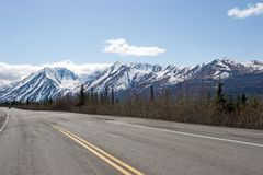Road in Alaska Range. Highway running by the Alaska Range Stock Photography