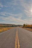 Road in the Alberta Foothills. Landscape of a road in the Alberta Foothills Royalty Free Stock Photography