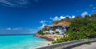 Road along a beach at Antigua island in the Caribbean Stock Photography