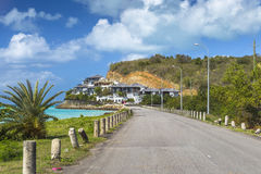 Road along a beach at Antigua island in the Caribbean Stock Images