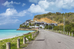 Road along a beach at Antigua island in the Caribbean Royalty Free Stock Photography