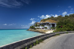 Road along a beach at Antigua island in the Caribbean Royalty Free Stock Image