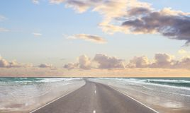 Road. Along the beach and blue sky Royalty Free Stock Image