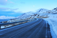 Road along the coast near Akureyri at twilight. Royalty Free Stock Images