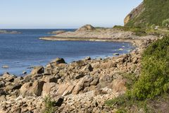 On the road along the coast of Niksund in Norway Stock Images