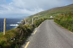 The road along the coast to Dunquin on Dingle peninsula. In Ireland Royalty Free Stock Images