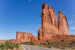 Road along the courthouse towers in Arches National Park Stock Image