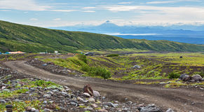 Road along dry river from the foot of Avachinskaya group Volcano on Kamchatka Peninsula Stock Photo