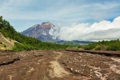 Road along dry river to the Volcano Koryaksky 3456 m on Kamchatka Peninsula Royalty Free Stock Image