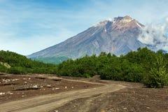 Road along dry river to the Volcano Koryaksky 3456 m on Kamchatka Peninsula Royalty Free Stock Photo