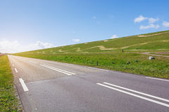 The road along The Hondsbossche Zeewering which is a 5.5 km long Stock Photos