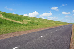 The road along The Hondsbossche Zeewering which is a 5.5 km long Royalty Free Stock Photo