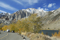 Road along a lake in Sierra Nevada mountains Stock Image