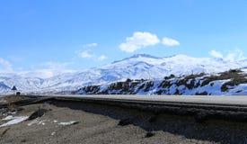 Road along Mount Ararat. A roadway along mount Ararat with clear blue sky in Turkey Royalty Free Stock Photos