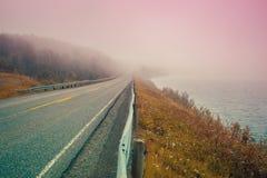 Road along mountain lake Stock Photos