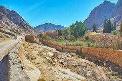 The way to St Catherine Monastery, Sinai, Egypt. The road along the mountain valley leads to the ancient St Catherine Monastery, Sinai, Egypt royalty free stock photography