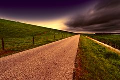 Road along Protective Dam and Canal Stock Photography