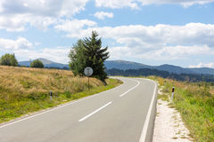 The road along the shore of Lake Vlasina in Serbia. Serbia's mountains are not only a local landmark, but also attract tourists from around the world - Serbia is Royalty Free Stock Photo