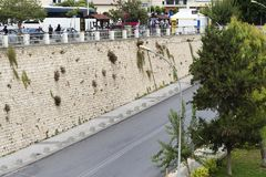 The road along the stone wall. Stock Image