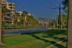 The road along which grow tall palm trees royalty free stock images