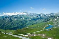 Road in Alps. Road between mountains in Alps, Austria Stock Photo