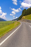 Road on Alps valley Stock Image