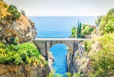 Road of Amalfi coast, Italy. Famous picturesque road viaduct of Amalfitana summer coast, Italy toned image Royalty Free Stock Image