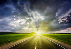 Free Road And Stormy Sky On Sunset Royalty Free Stock Photo - 52651955