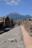 Street and Houses with Vesuvius, Pompeii Archaeological Site, Campania, Italy Stock Photo