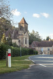 Road in Aquitaine. Stones house and a church is situated in aquitaine france. It is a vertical image on a sunny day stock photos